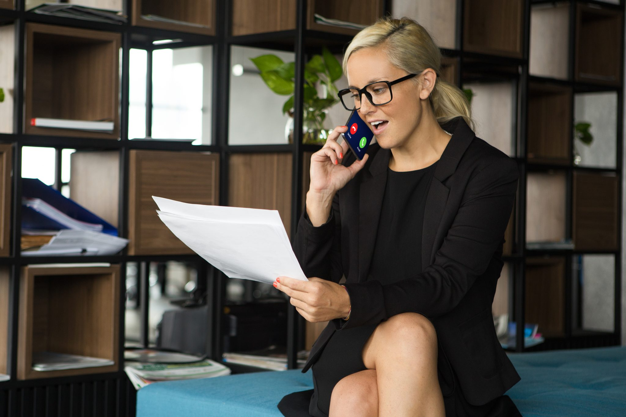 woman on phone dictating her notes
