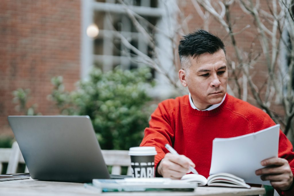 Market researcher analyzing interview transcriptions made by transcriptionists