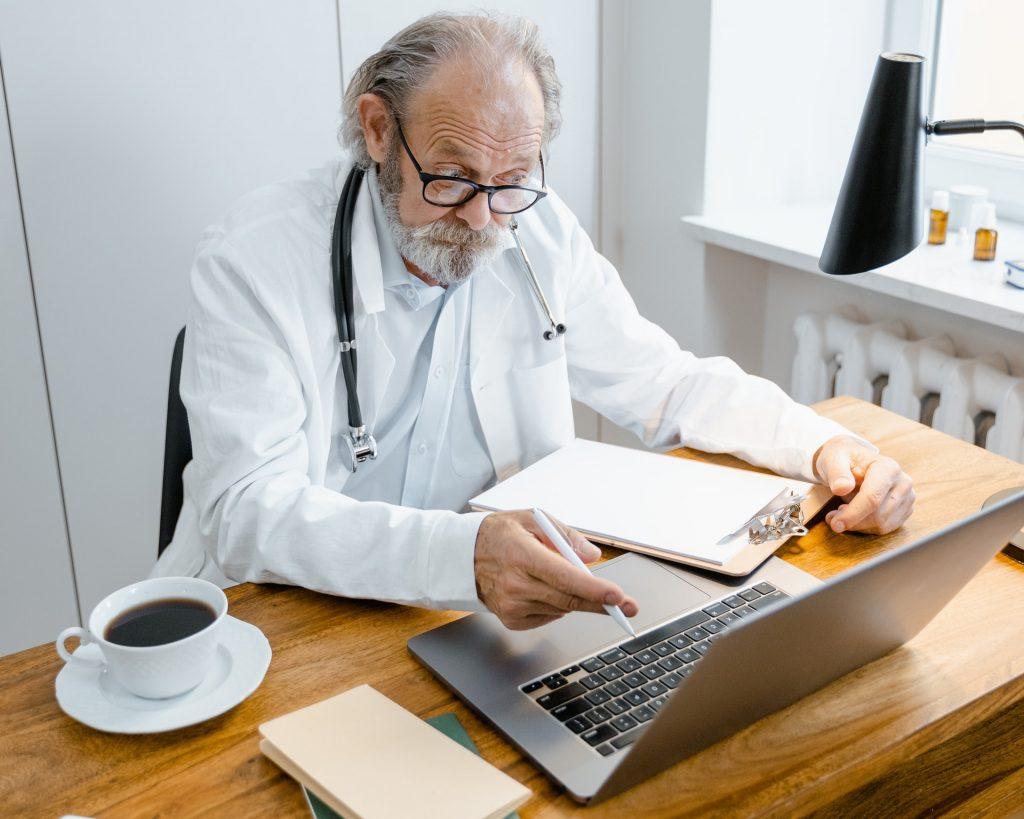 Doctor reading medical transcriptions